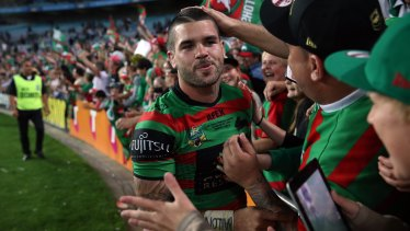 Adam Reynolds celebrates with Rabbitohs fans after starring in the 2014 grand final victory.