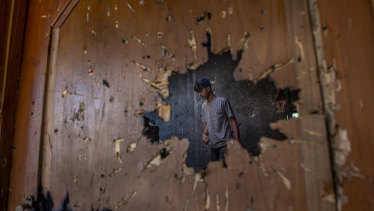Kashmir has been a scene to violence before. Here a Kashmiri man inspects a house with a hole created by a mortar shell fired by government forces during a gunfight, in Srinagar, Indian-controlled Kashmir in February.