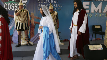 A couple playing the role of Jesus Christ and Mary walk in the Fuego Nuevo Museum during a presentation of the actors of the Stations of the Cross Passion Play in  Mexico City.