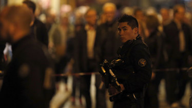 A police officer watches on after a knife attack in central Paris on Saturday.