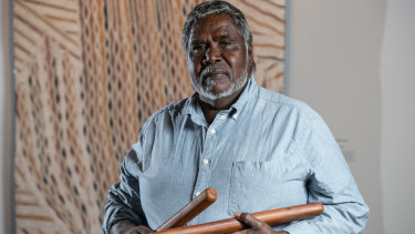Artist Djambawa Marawili AM from Yilpara in the Northern Territory in front of his work 'Journey to America', 2018.