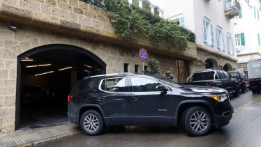 A car leaves the garage of a property owned by Carlos Ghosn in Beirut, Lebanon.