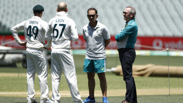 Steve Smith and Nathan Lyon talking with Justin Langer and Australian Chairman of Selectors Trevor Hohns.