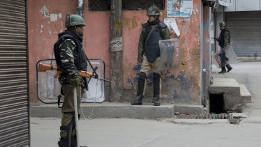 Indian paramilitary soldiers stand guard in Srinagar, Indian-controlled Kashmir.