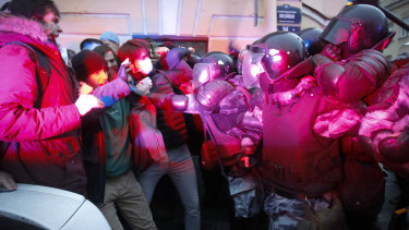 People clash with police during a protest in support of Alexei Navalny in St Petersburg, Russia.