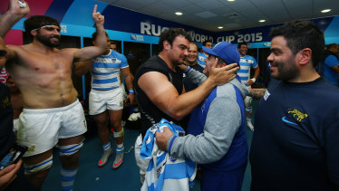Diego Maradona celebrates with Agustin Creevy in the Argentina dressing room at the 2015 Rugby World Cup.