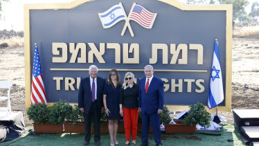 Benjamin Netanyahu, right, his wife Sara , US ambassador to Israel David Friedman, and his wife Tammy pose during the inauguration of a new settlement named after President Donald Trump in the Golan Heights.