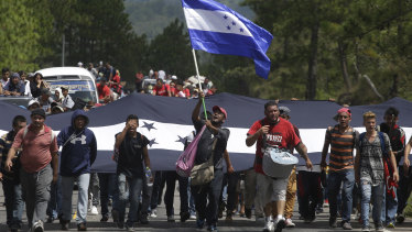 Hondurans march in a caravan of migrants moving toward the country's border with Guatemala.