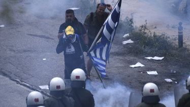 Riot Police clash with protesting opponents of the deal between Greece and Macedonia in northern Greece on Sunday.