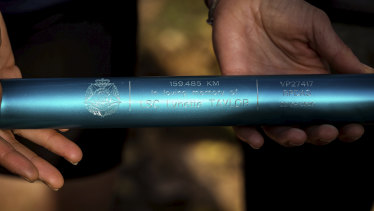 The four blue batons were inscribed with the names of the fallen officers.