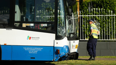 The woman in her 30s died after being struck by a bus full of school children in Newcastle.