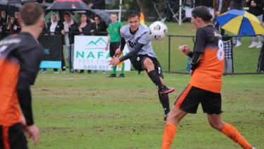 Macarthur midfielder Denis Genreau curls a shot on goal.