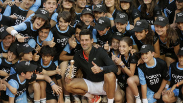 'Cringe-worthy': Novak Djokovic with the ball kids after winning the Madrid Open. Kyrgios isn't his biggest fan.
