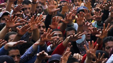 A group of students protest against the dismissal of the murder case against toppled president Hosni Mubarak over the killing of protesters during Egypt's 2011 uprising, at Cairo University in 2014.
