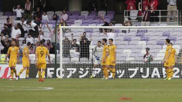 Unbelievable: The dejected Socceroos after Jordan's first-half goal.