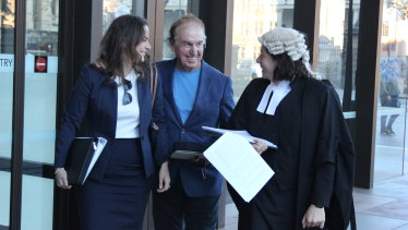 Dr John O'Neill (centre) leaves the NSW Supreme Court on Thursday.
