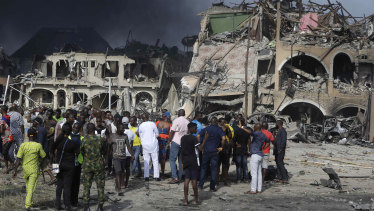 People gather near the site of an explosion in Lagos, Nigeria.