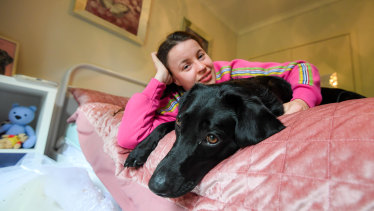Eliza Robbins-Brown with her TAC-funded dog, Harmony.