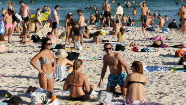 Bondi Beach on Friday, March 20, when thousands flocked to the water, ignoring social distancing edicts.