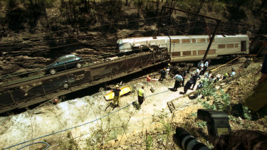 Locked in a deadly embrace... Scene of the train crash at Glenbrook, NSW on December 2, 1999.