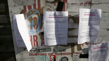 Protest flyers posted outside the safe injecting room at North Richmond Community Health.