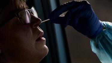 A woman receives a COVID-19 swab test in Sydney.