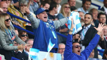 Diego Maradona celebrates an Argentina try against Tonga at the 2015 Rugby World Cup.