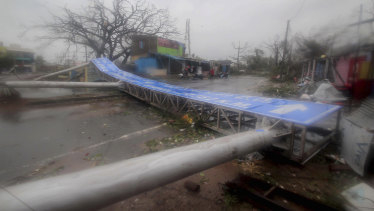 Damaged signage lies on a street in Puri, India, after cyclone Fani hit.
