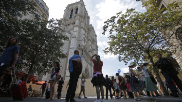 People gather near Notre-Dame Cathedral.