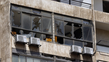 Broken windows are seen on the 11-floor building that houses the media office in a stronghold of the Lebanese Hezbollah group in a southern suburb of Beirut, Lebanon.