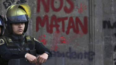 A guard outside the National Palace, the presidential office and residence, during a demonstration against gender violence in Mexico City.