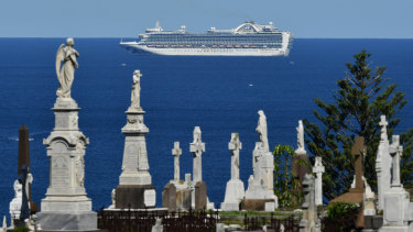 The cruise ship the ruby Princess sits of coast of Sydney on Sunday.