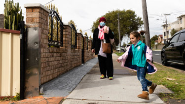"""Ema Akl collects her daughter from childcare in Chester Hill in the Canterbury-Bankstown LGA which is an """"area of concern"""". She is an essential worker in a supermarket and is fully vaccinated."""