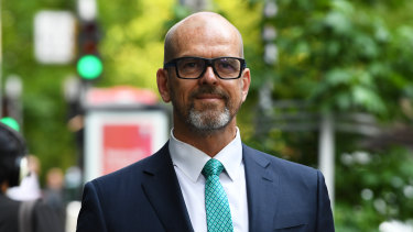 Former police chief Simon Overland arrives at the royal commission on Tuesday.