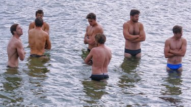 Carlton players take to Brighton Beach the day after their crushing loss to the Kangaroos.