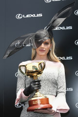 Lady Kitty Spencer at the 2019 Melbourne Cup, wearing a hat by Stephen jones and dress by Roland Mouret.