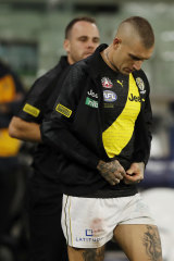 Dustin Martin puts on a jacket after leaving the ground with concussion.