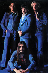 Alan Lancaster (centre standing) with Status Quo.