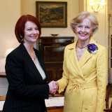 Julia Gillard, left, shakes hands with Governor General Quentin Bryce after Gillard was sworn in as prime minister at Government House in Canberra, Australia, Thursday, June 24, 2010.