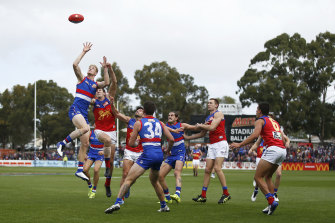 Tim English soars against the Lions.