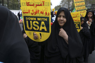 Demonstrators hold anti-US banners during a rally in front of the former US embassy in Tehran, Iran, on Monday.