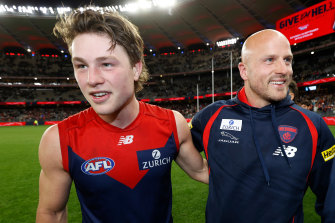 Nathan Jones (right) with Tom Sparrow after Friday night's big win by the Demons to advance to the grand final.