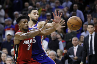 Ben Simmons reaches for the ball against former teammate Jimmy Butler, who received a hostile reception.