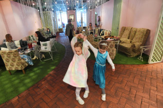 Harper and Scarlett, children of Madame Brussels customers, have a dance.