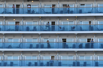 Crew on board the Ruby Princess as the cruise liner docks at Port Kembla on Monday