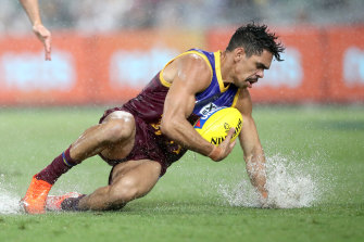 Charlie Cameron splashes after the ball as rain fell early on at the Gabba.