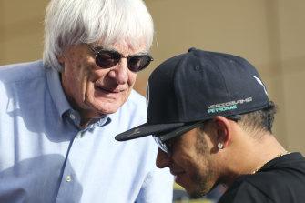 Bernie Ecclestone with Lewis Hamilton at the Bahrain Grand Prix in 2015.