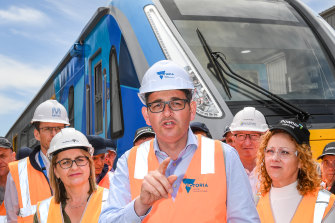 Mr Andrews and Ms Allan (left) at the announcement of the train project in 2016.