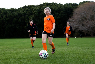 Siblings Finnair, Elena and Ishbel Collins from the Balmain and District Football Club having a kick before training resumes for them all next week.