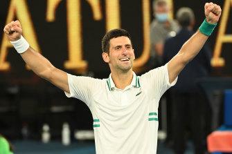 Novak Djokovic celebrates his ninth Australian Open title.